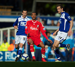 BIRMINGHAM, ENGLAND - Sunday, April 4, 2010: Liverpool's David Ngog in action against Birmingham City during the Premiership match at St Andrews. (Photo by David Rawcliffe/Propaganda)