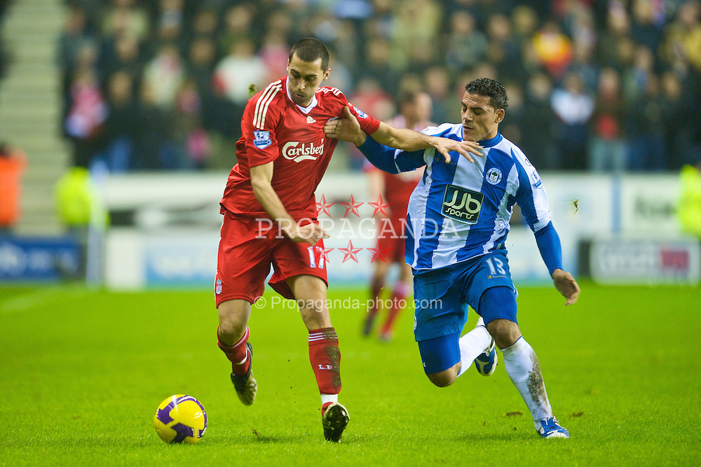 WIGAN, ENGLAND - Wednesday, January 28, 2009: Liverpool's Alvaro Arbeloa and Wigan Athletic's Amr Zaki during the Premiership match at the JJB Stadium. (Mandatory credit: David Rawcliffe/Propaganda)