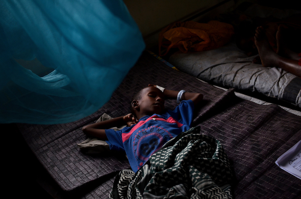 A malnourished boy sleeps under doctor supervision at the MSF clinic in Dagahaley refugee camp in Dadaab, Kenya.