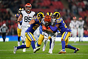 Cincinnati Bengals Wide receiver Alex Erickson (12) is tackled by LA Rams Defensive back Taylor Rapp (24) and LA Rams Defensive back Jalen Ramsey (20) during the International Series match between Los Angeles Rams and Cincinnati Bengals at Wembley Stadium, London, England on 27 October 2019.