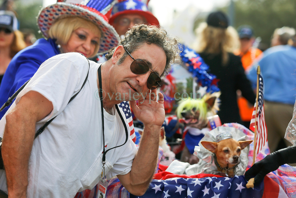 31 January 2016. New Orleans, Louisiana.<br /> Mardi Gras Dog Parade. Lee Celano leads dance troupe Gris Gris Strut. The Mystic Krewe of Barkus winds its way around the French Quarter with dogs and their owners dressed up for this year's theme, 'From the Doghouse to the Whitehouse.' <br /> Photo©; Charlie Varley/varleypix.com