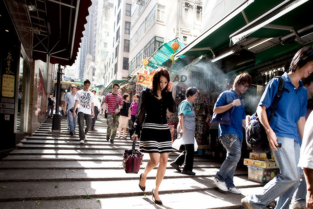 """Old pedestrian streets, Central, Hong Kong Island. *** General Caption *** Hong Kong - referred to officially as the """"Hong Kong Special Administrative Region"""" by the Chinese government - was under British administration from 1842 until a transfer of sovereignty to the People's Republic of China in 1997. Today, the region operates with a great degree of autonomy under the Sino-British Joint Declaration, which provides for semi-autonomous status until at least 2047. Hong Kong's sovereignty is protected by the declaration except in areas regarding national defense and foreign relations, which are overseen by China's national government in Beijing. The region's status as China's wealthiest urban center is owed in large part to the nature of its highly capitalist economy, which boasts free markets, low taxation and government non-intervention. An important center for international finance and trade, Hong Kong - which lacks natural resources and has little arable land - operates via an economy dominated by services, which accounts for over 90 percent of the region's gross domestic product."""
