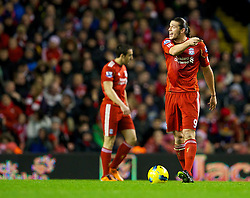 LIVERPOOL, ENGLAND - Friday, December 30, 2011: Liverpool's Andy Carroll looks dejected as Newcastle United score the opening goal during the Premiership match at Anfield. (Pic by David Rawcliffe/Propaganda)
