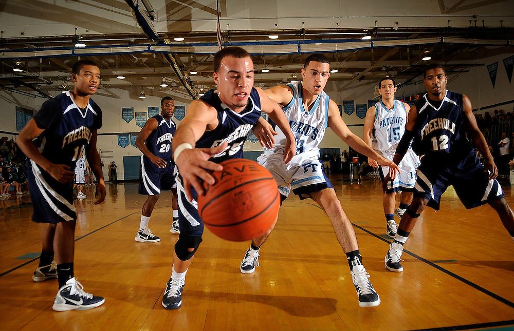 Freehold Borough's Chris Torre (middle) tries to get a handle on the ball during second half of the game against Freehold Township held at Freehold Township High School on January 7, 2011.