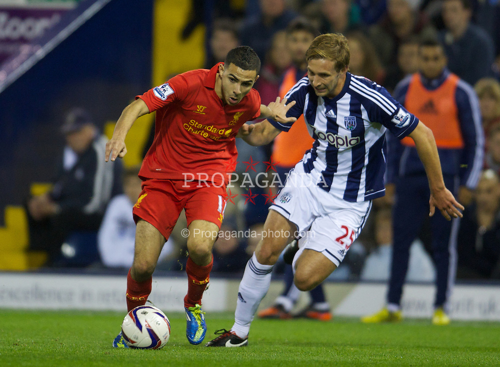 WEST BROMWICH, ENGLAND - Wednesday, September 26, 2012: Liverpool's Oussama Assaidi in action against West Bromwich Albion's Craig Dawson during the Football League Cup 3rd Round match at the Hawthorns. (Pic by David Rawcliffe/Propaganda)