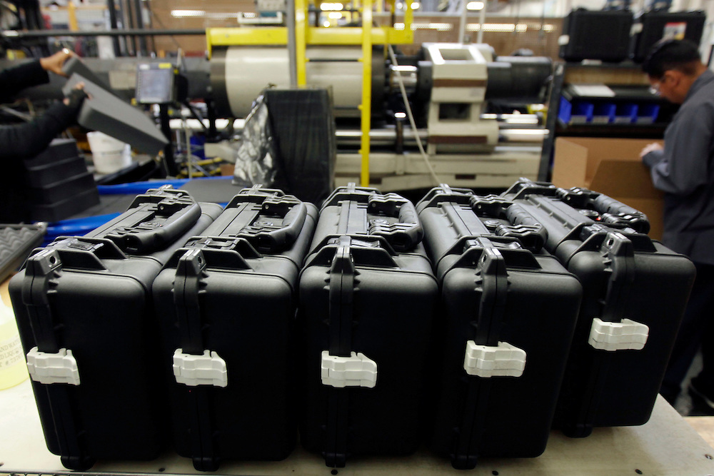 Fully assembled injection-molded plastic hardshell cases wait to be packaged before shipment at the Pelican Products Inc. production facility in Torrance, California, U.S., on Thursday, March 8, 2012.  © 2012 Patrick T. Fallon