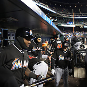 NEW YORK, NEW YORK - APRIL 12: Giancarlo Stanton, (center), Miami Marlins, preparing to bat in the dugout with teammates during the Miami Marlins Vs New York Mets MLB regular season ball game at Citi Field on April 12, 2016 in New York City. (Photo by Tim Clayton/Corbis via Getty Images)