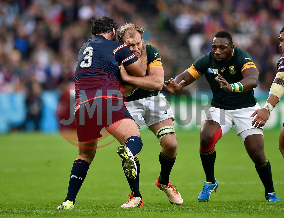 Schalk Burger of South Africa is tackled by Chris Baumann of the USA - Mandatory byline: Patrick Khachfe/JMP - 07966 386802 - 07/10/2015 - RUGBY UNION - The Stadium, Queen Elizabeth Olympic Park - London, England - South Africa v USA - Rugby World Cup 2015 Pool B.