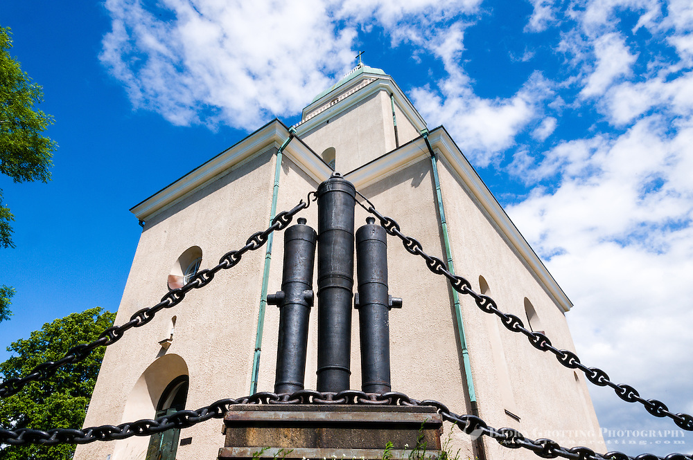 Finland, Helsinki. Cannons outside Suomenlinna church.