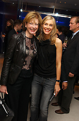 Left to right, JULIA PEYTON-JONES and KIM HERSOV at a dinner hosted by Cartier to celebrate the opening of the 2004 Frieze Art Fair, held at Yauacha 15-17 Broadwick Street, London W1 on 13th October 2004.<br />