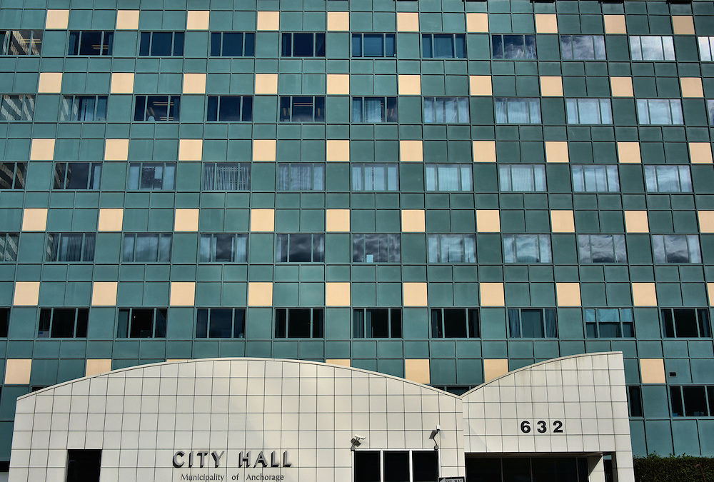 New City Hall Building in Anchorage, Alaska <br /> This postmodernism City Hall, with its green and beige checkerboard cladding, was one of several buildings built after the area was devastated by the Great Alaska Earthquake in 1964.  At the time, there was a debate about whether to rebuild portions of the downtown after it suffered such extensive damage.