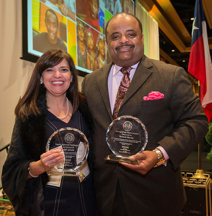 Aleida Rios and Roland Martin pose for a photograph with their distinguished alumni awards during the State of the Schools luncheon at the Hilton of the Americas, February 15, 2017.