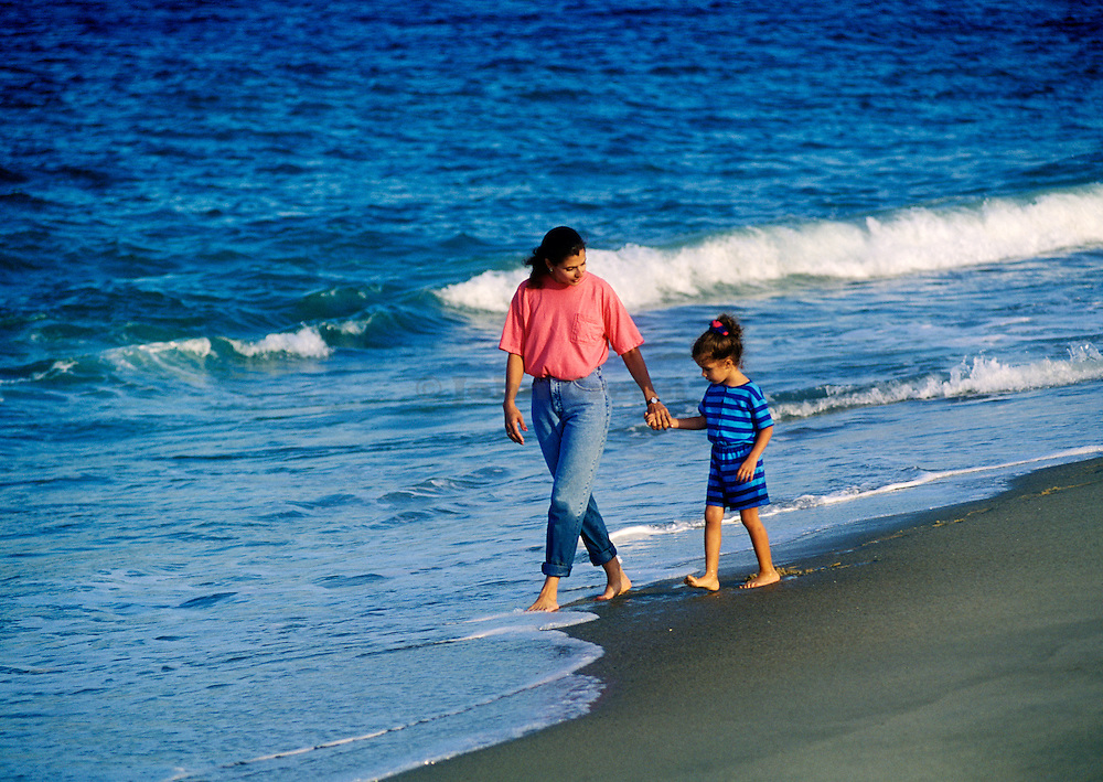 Mother walks with her daughter along the beach. Nauset Beach  Massachusetts, Cape Cod.