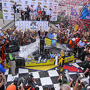 Tony Stewart (14) of Stewart-Haas Racing celebrate in victory lane after winning the NASCAR SPRINT CUP SERIES FEDEX 400 BENEFITING AUTISM SPEAKS  at Dover International Speedway in Dover, DE., Sunday,  June 02, 2013.1