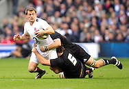 © Andrew Fosker / Seconds Left Images 2010 - England's Mark Cueto  is caught by New Zealand's Samuel Whitelock  (5) & New Zealand's Richie McCaw (Captain)  England v New Zealand All Blacks - Investec Challenge Series - 06/11/2010 - Twickenham Stadium  - London - All rights reserved..