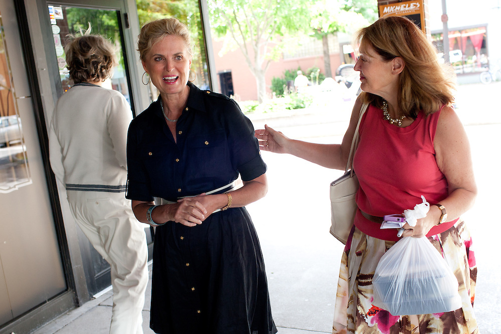 Political aide Susan Duprey (R) talks to Ann Romney, the wife of Mitt Romney, after a campaign event at Michele's Ristorante in Keene, NH on August 11, 2011.  (Matthew Cavanaugh for The Boston Globe)