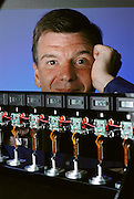 Rod MacGregor, president and CEO of NanoMuscle, Inc. standing behind Life cycle testers: NanoMuscles are cycled continuously on these testers for months at a time to prove reliability. NanoMuscles are rated at one million cycles, but some samples have exceeded 12 million cycles and are still running. NanoMuscle, a California company headed by Scotsman Rod MacGregor, makes miniature motors, which are smaller and lighter than the conventional electric devices that go into everyday products such as digital cameras and CD players. Model Released