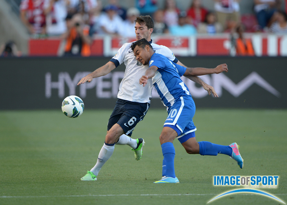 Jun 18, 2013; Sandy, UT, USA; United States defender Brad Evans (6) and Honduras forward Mario Martinez (10) battle for the ball in a FIFA World Cup Qualifier at Rio Tinto Stadium.