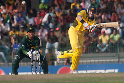 ©London News Pictures. 19/03/2011.Michael Hussey chips one toMisbah-ul-Haq & gets out for 12 at R.Premadasa Stadium Colombo Sri Lanka