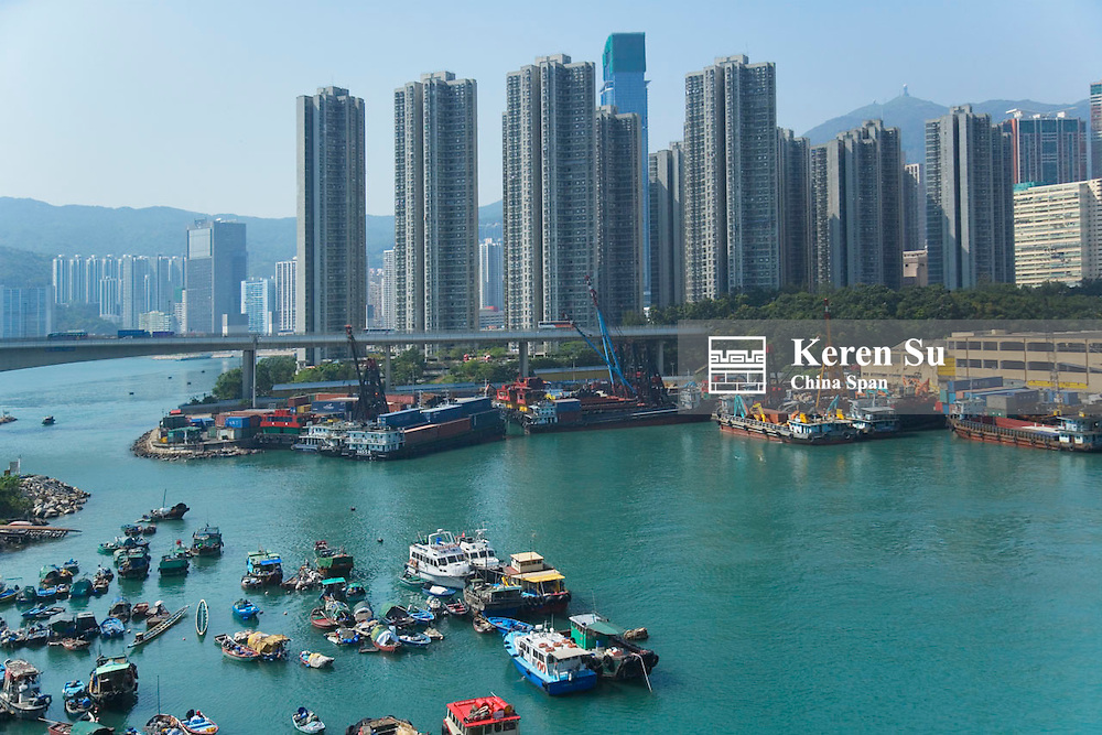 Highrises and boats in Victoria Bay, Hong Kong, China