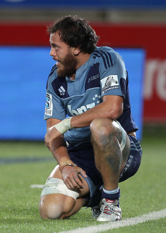 Blues Chris Lowrey despairs after failing to prevent the Hurricanes scoring a try in the last minute to win the Super Rugby match, Eden Park, Auckland, New Zealand, Friday, March 23, 2012.  Credit:SNPA / David Rowland