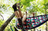 Festival goers chilling in their hammock.