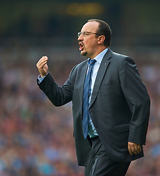 LONDON, ENGLAND - Saturday, September 19, 2009: Liverpool's manager Rafael Benitez urges his side on against West Ham United during the Premiership match at Upton Park. (Pic by David Rawcliffe/Propaganda)