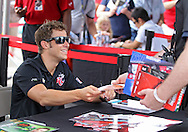Marco Andretti signs autographs before the start of the IZOD IndyCar Iowa Corn Indy 250 auto race at the Iowa Speedway in Newton, Iowa on Saturday, June 23, 2012.