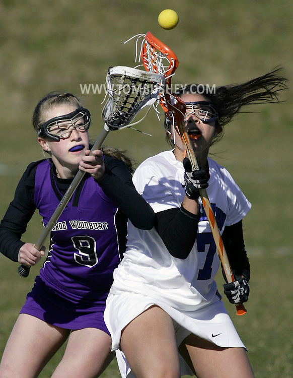 Monroe-Woodbury's Spencer Pavia and Middletown's Gabrielle Flores battle for the ball during a game in Middletown on Monday, April 2, 2012.
