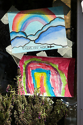 © Licensed to London News Pictures. 13/04/2020. London, UK. Hand painted pictures of rainbows are seen in a window of a house in north London. Rainbows are used as a symbol of peace and hope. Coronavirus lockdown continues to slow the spread of COVID-19 and reduce pressure on the NHS. Photo credit: Dinendra Haria/LNP