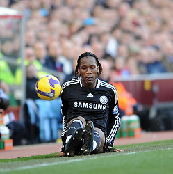 Didier Drogba of Chelsea  falls during the Barclays Premier League match between Aston Villa and Chelsea at Villa Park on February 21, 2009 in Birmingham, England.