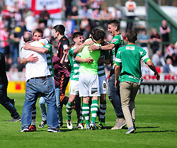 Fans run onto the pitch as Yeovil Town reach the play off finals - Photo mandatory by-line: Dougie Allward/JMP - Tel: Mobile: 07966 386802 06/05/2013 - SPORT - FOOTBALL - Huish Park - Yeovil - Yeovil Town V Sheffield United - NPOWER LEAGUE ONE PLAY-OFF SEMI-FINAL SECOND LEG