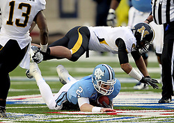 Missouri defensive back Randy Ponder (7) flies over North Carolina quarterback Bryn Renner (2) after a dive for a first down during the first quarter of the Independence Bowl college football game against Missouri in Shreveport, La., Monday, Dec. 26, 2011.