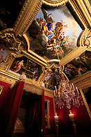 Ornate gold, statues and artwork line the rooms of the Palace of Versailles on the outskirts of Paris, France