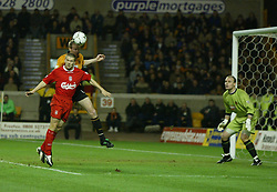 WOLVERHAMPTON, ENGLAND - Wednesday, January 21st, 2004: Liverpool's Michael Owen challenges for a header against during the Premiership match against Wolverhampton Wanderers at Molineux. (Pic by David Rawcliffe/Propaganda)