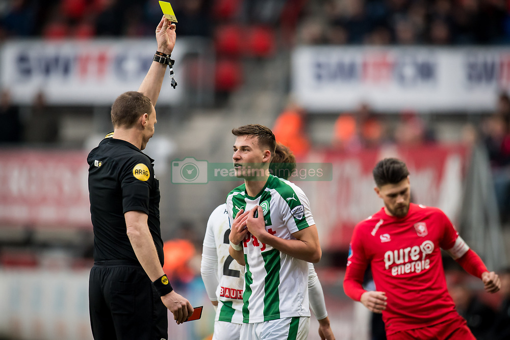 (L-R) referee Ed Janssen, Tom van de Looi of FC Groningen during the Dutch Eredivisie match between FC Twente Enschede and FC Groningen at the Grolsch Veste on March 04, 2018 in Enschede, The Netherlands