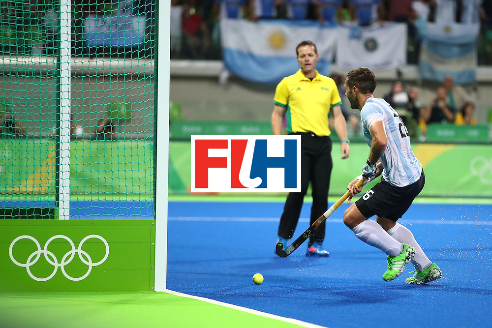 RIO DE JANEIRO, BRAZIL - AUGUST 18:  Agustin Mazzilli #26 of Argentina  scores a goal during the Men's Hockey Gold Medal match between Belgium and Argentina on Day 13 of the Rio 2016 Olympic Games at Olympic Hockey Centre on August 18, 2016 in Rio de Janeiro, Brazil.  (Photo by Clive Brunskill/Getty Images)