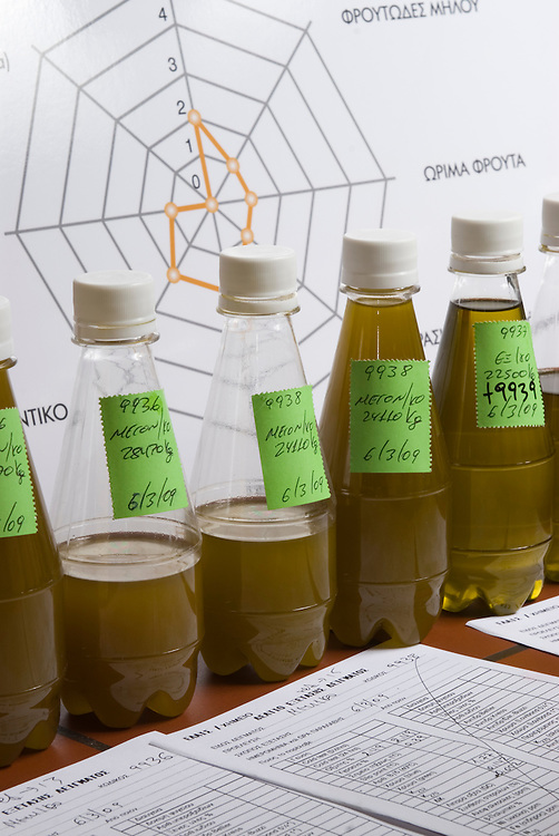 bottles of raw olive oil for testing at the plants' laboratory