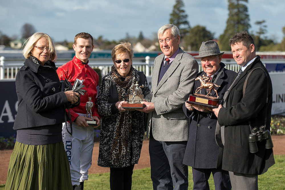 Jockey Michael Mitchell with the connections of High Forty after winning race 7 141st NZ Grand National Steeplechase at Riccarton Park, Christchuch, New Zealand, Saturday, August 08, 2015. Credit:SNPA / Martin Hunter