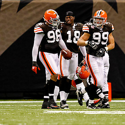 Oct 24, 2010; New Orleans, LA, USA; Cleveland Browns linebacker David Bowens (96) is congratulated by teammates after scoring a touchdown against the New Orleans Saints during the second half at the Louisiana Superdome. The Browns defeated the Saints 30-17.  Mandatory Credit: Derick E. Hingle
