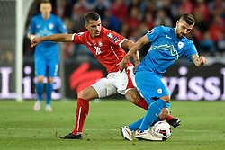 05.09.2015, St. Jakob Park, Basel, SUI, UEFA Euro 2016 Qualifikation, Schweiz vs Slowenien, Gruppe E, im Bild Granit Xhaka (SUI) gegen Dalibor Stevanovic (SVN) // during the UEFA EURO 2016 qualifier group E match between Switzerland and Slovenia at the St. Jakob Park in Basel, Switzerland on 2015/09/05. EXPA Pictures © 2015, PhotoCredit: EXPA/ Freshfocus/ Urs Lindt<br /> <br /> *****ATTENTION - for AUT, SLO, CRO, SRB, BIH, MAZ only*****