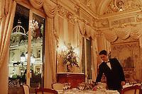 February 1997, Monte-Carlo, Monaco --- Waiter Preparing a Dining Table --- Image by © Owen Franken/CORBIS
