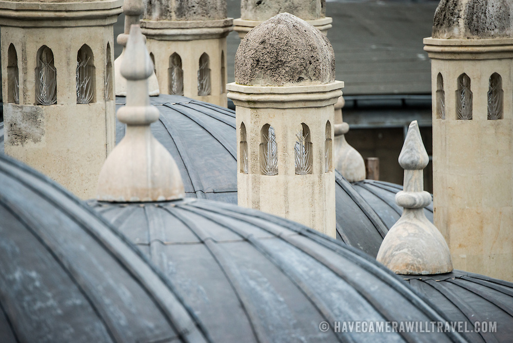 Domed rooftops adjacent to Suleymaniye Mosque looking out over the city of Istanbul towards Beyoglu. Dedicated to Suleiman the Magnificent (or Suleiman I), the longest-reigning Ottoman Sultan (1520-1566), Süleymaniye Mosque stands prominently on Istanbul's Third Hill and is considered the city's most important mosque. It was completed in 1558.