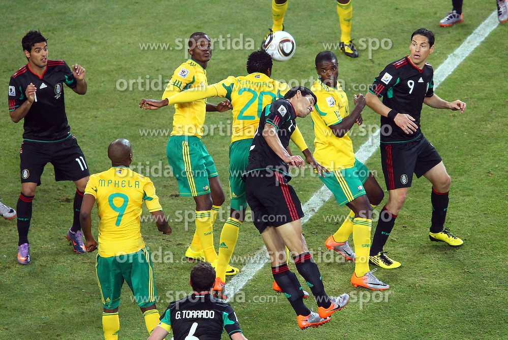 South Africa's Bongani Khumalo (20) vs Mexico's Francisco Rodriguez during the Group A first round 2010 FIFA World Cup South Africa match between South Africa and Mexico at Soccer City Stadium on June 11, 2010 in Johannesburg, South Africa.  (Photo by Vid Ponikvar / Sportida)
