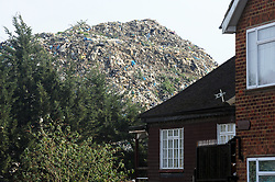 FILE PICTURE © Licensed to London News Pictures. 11/03/2016<br /> Abandoned rubbish mountain (Waste4fuel site) on fire again this afternoon.<br /> The Waste4fuel site in St Pauls Cray,Orpington,Kent continues to be an eyesore and a blight to the local community. Legal issues are holding up the removal of the rubbish from the site.<br /> <br />  (Byline:Grant Falvey/LNP)