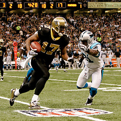 Nov 08, 2009; New Orleans, LA, USA;  New Orleans Saints wide receiver Robert Meachem (17) runs from Carolina Panthers cornerback Richard Marshall (31) during the third quarter at the Louisiana Superdome. The Saints defeated the Panthers 30-20. Mandatory Credit: Derick E. Hingle
