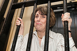 © Licensed to London News Pictures . 15/11/2012 . Manchester , UK . Former Minister EDWINA CURRIE behind bars at a Jail and Bail fundraising event for the British Red Cross . The event , which took place at the Manchester Police Museum , sees high profile lawyers answering mock charges before being taken to the cells and having to raise £999 bail (donated to the Red Cross) to secure their release . Photo credit : Joel Goodman/LNP