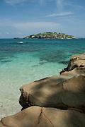 Rocky shore with clear waters, Pacheca island. Las Perlas archipelago, Panama province, Panama, Central America.