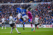 Sean Morrison of Cardiff City heads at goal challenged by Freddie Woodman of Swansea City during the EFL Sky Bet Championship match between Cardiff City and Swansea City at the Cardiff City Stadium, Cardiff, Wales on 12 January 2020.
