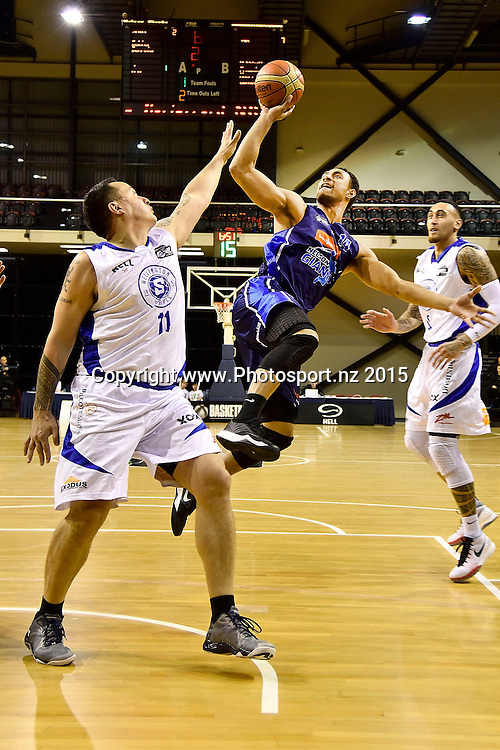 Mika Vukona (R of the Giants jumps to shoot with Brendon Polblank of the Saints during the NBL semi final basketball match between Wellington Saints and Nelson at the TSB Arena in Wellington on Saturday the 4th of July 2015. Copyright photo by Marty Melville / www.Photosport.nz